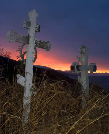 graves on Kodiak Island with a colorful sunset Stock Photo - 2920207