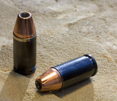 self defense: 9 mm hollow point self defense rounds in copper Stock Photo