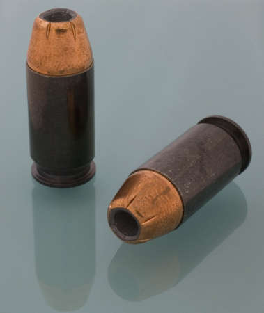 45 gun: hollow point bullets for a 45 ACP handgun Stock Photo