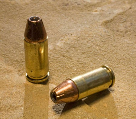use pistol: hollowpoint ammunition loaded and ready for use in a pistol Stock Photo