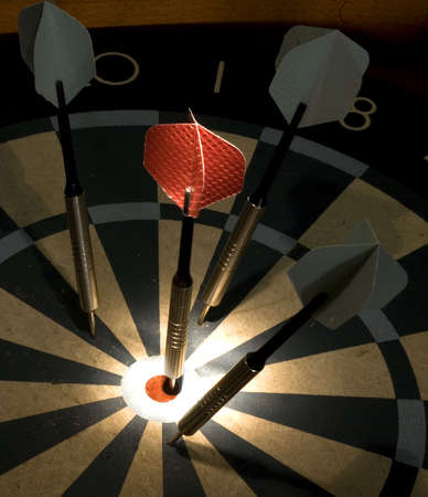 a dart on target during an indoor game Banco de Imagens