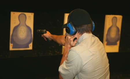 marksman at the range practicing with a flashlight 版權商用圖片 - 2968905