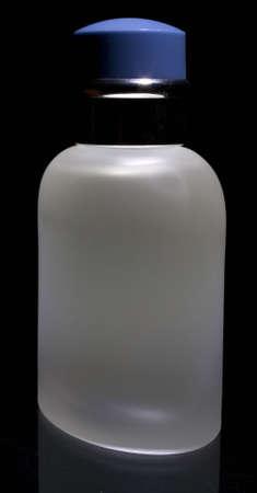 cologne in a translucent bottle on black