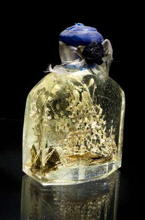 special perfume backlit on a black background Banco de Imagens
