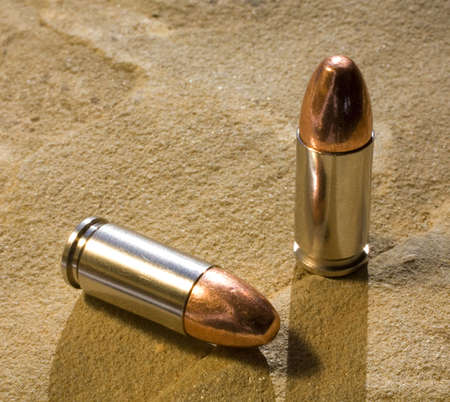projectile: bullets on sandstone with a strong back light