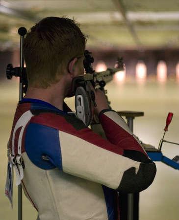 shooting competitor taking aim at his target