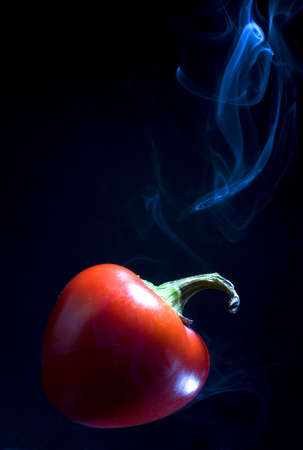 red pepper so hot that smokes coming out Stock Photo