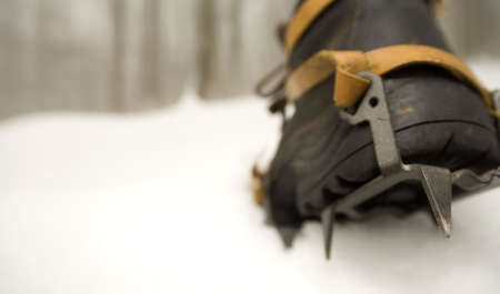 crampons: a boot and crampon on the snow and ice