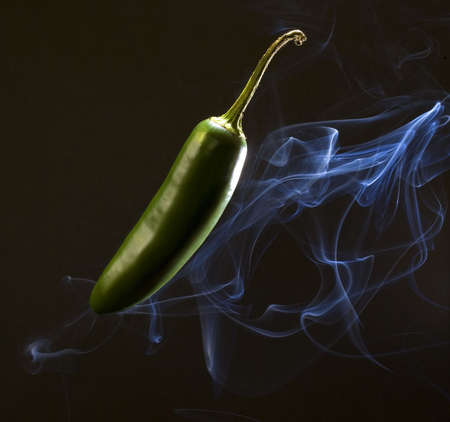 spicy pepper so hot that it is smoking photo