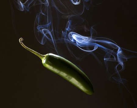 pepper thats so spicy that it is smoking photo
