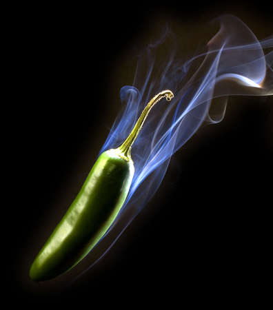 green pepper thats so hot its smoking Stock Photo