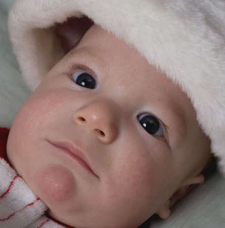 infant that looks shocked wearing a Christmas cap Stock Photo - 3969029
