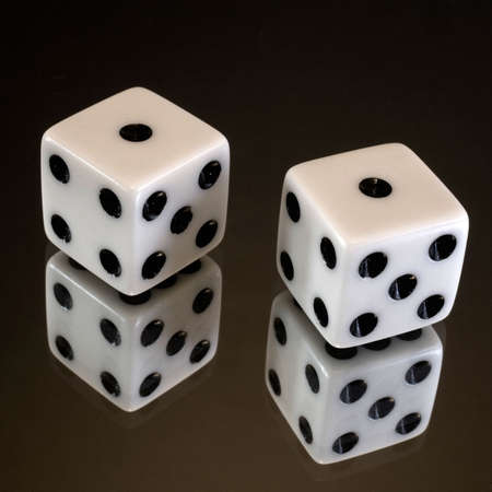 a set of dice that has rolled snake eyes