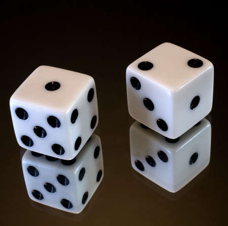 a pair of dice that have rolled a three