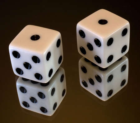 a pair of dice that have rolled a pair of ones