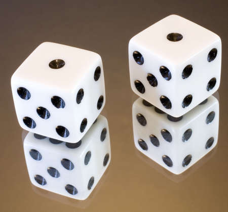 a pair of dice that have rolled double ones