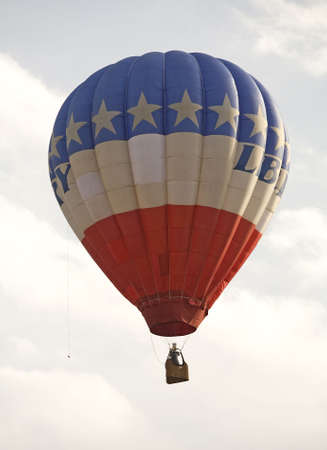 hot air balloon that is crossing a blue sky