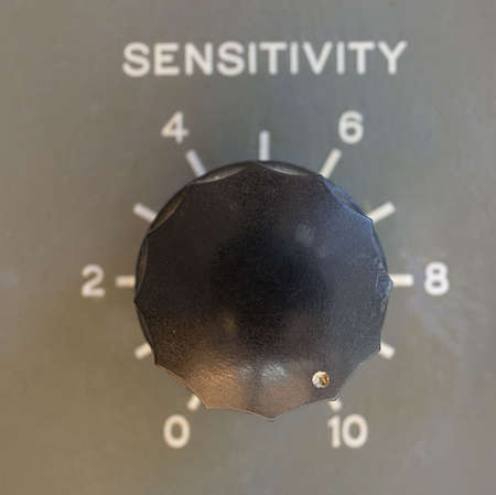 sensitivity: old ham radio dial with its sensitivity turned up to 10 Stock Photo