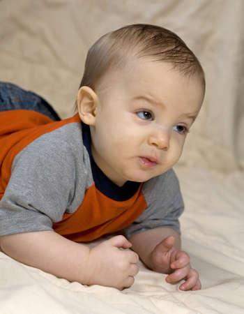 scheming: infant that looks like he is plotting a revenge