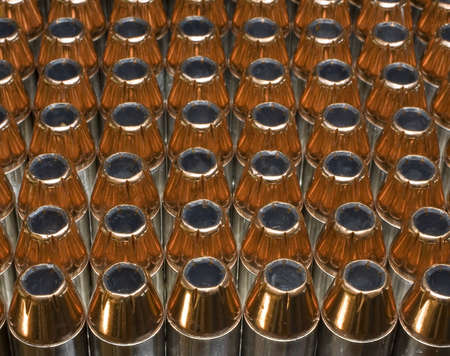 cartridges for 45 ACP pistols that are topped with hollow points 写真素材