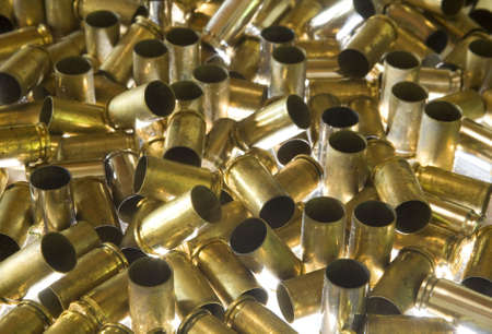 expended: ammunition for a handgun that has been expended in a pile Stock Photo