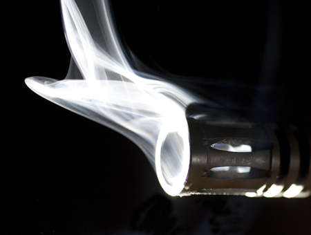 flash hider: por barril en un arma que es tan caliente que es el tabaquismo