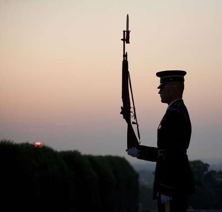 guard at the tomb of the unknowns as the sun comes up Stock Photo