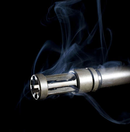flash hider: cloud of smoke that is leaving the barrel of a gun