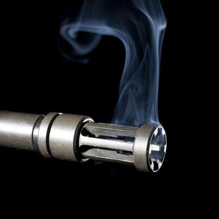 hider: flash hider on an assault rifle that is still smoking