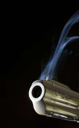 gun belching smoke as it bounces from the shot