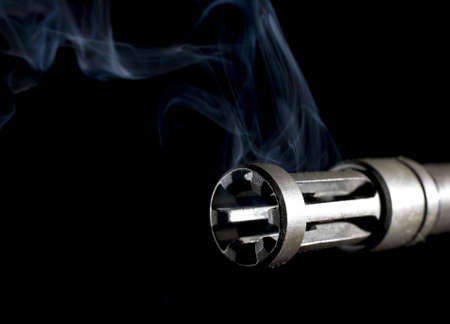 flash hider: flash hider on the barrel of an assault rifle with smoke