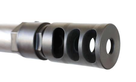 high powered: muzzle brake on the end of a high powered rifle