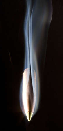copper-colored bullet that is very hot as it speeds Stock Photo