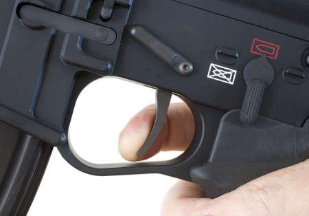 finger on trigger: finger on the trigger of a black assault rifle