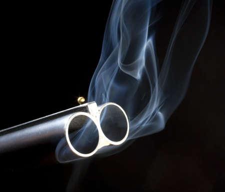 Both barrels on a double barreled shotgun that are smoking 版權商用圖片 - 7083905