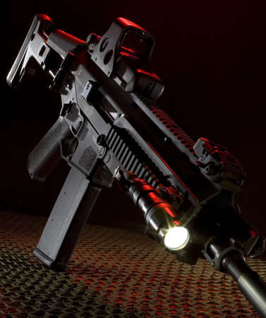 assault rifle on netting with a back light that is red