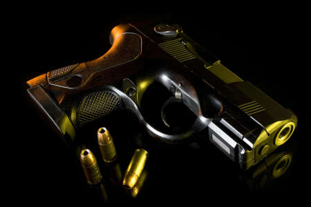 gels: black handgun on glass with orange and yellow gels