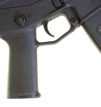 Pistol grip and the trigger group on an assault weapon