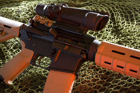 semi-automatic rifle with a high capacity magazine with scope