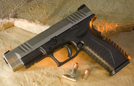Semi automatic handgun that has a polymer frame and steel slide Stok Fotoğraf
