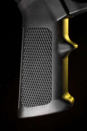 grip: Assault rifles polymer pistol grip with yellow gels Stock Photo