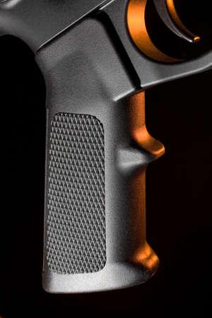 grip: Grip that is found on most modern assault rifles Stock Photo