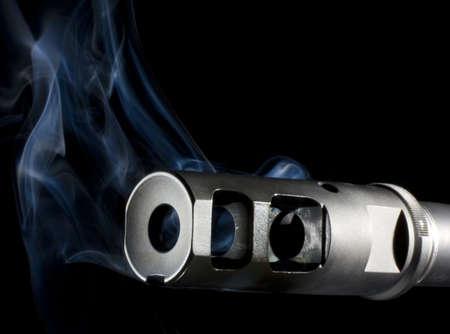 hider: Flash suppressor on an assault rifle billowing blue smoke