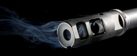 flash hider: Muzzle of an AR that is pouring out blue smoke