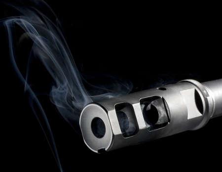 flash hider: fogonazo en un AR que es eructo fuera humo azul