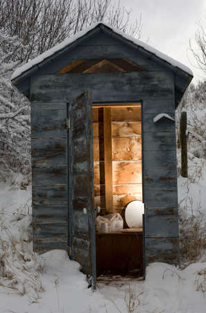 outhouse: out house that is covered in a wintertime snow Stock Photo