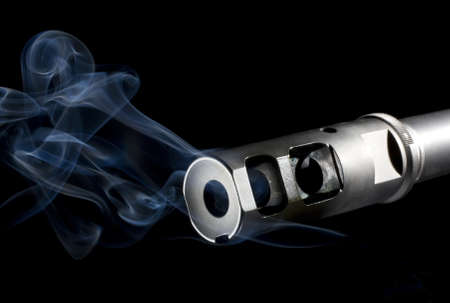 hider: Flash hider on an assault rifle that is emitting blue smoke