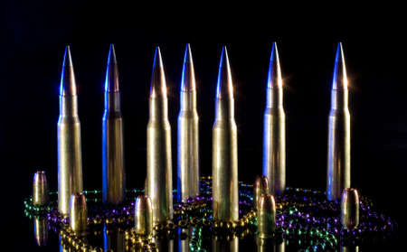 Fifty caliber rifle ammunition and pistol ammunition with Mardi Gras beads