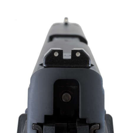 lining up: Front and rear sights lining up on a polymer handgun