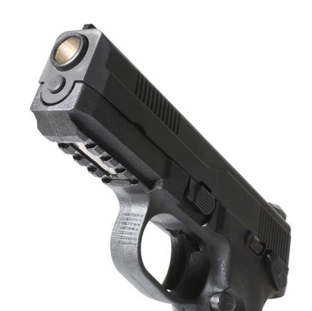 handgun that has its muzzle lit up to see the rifling Banco de Imagens - 9552961